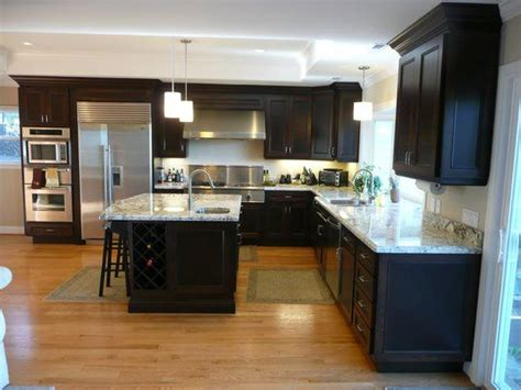 Black Stained Kitchen Cabinets Kitchen With Espresso Stained Cherry Cabinets Granite Counter Tops And Oak Hardwood