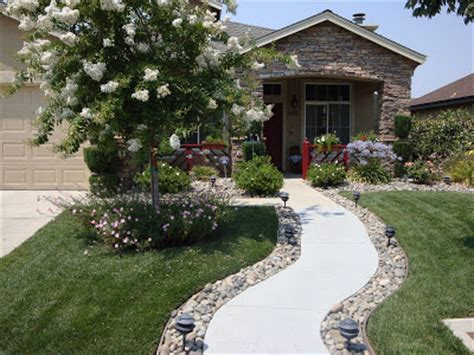 curved sidewalk in front of side entry garage love it home is where the heart is our first entry welcome to