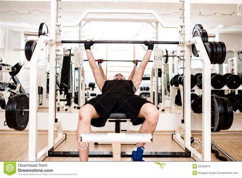 gym chest bench bodybuilder training in the gym chest barbell bench