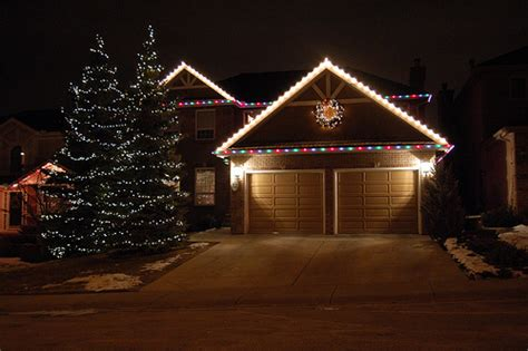 simple christmas lights on houses happy holidays