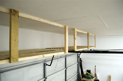 overhead garage door storage adding storage above the garage door jays custom creations