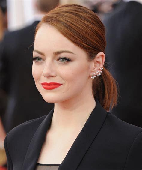emma stone earrings how to wear statement earrings with style