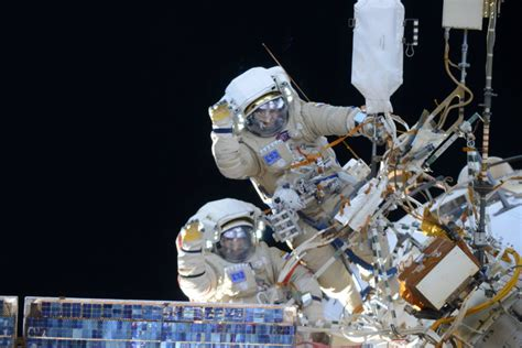 outside space cosmonauts taking spacewalk outside space station today