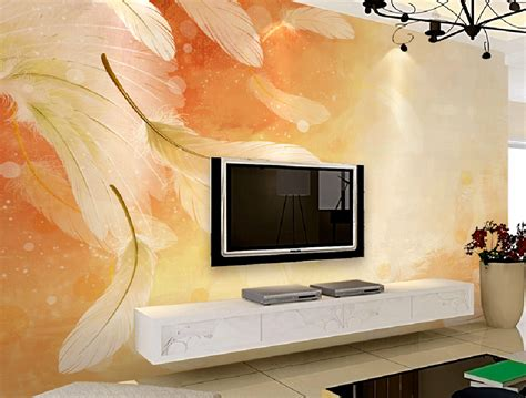 Living room TV wall design with feather wallpaper