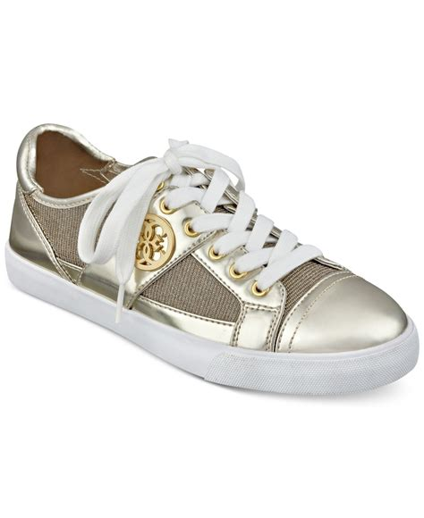 womens gold sneakers guess s macby lace up sneakers in gold lyst