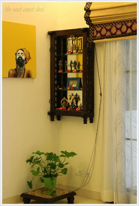 wall mounted pooja cabinet a section of the dining room has been dedicated as the