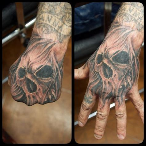 hand tattoo leaking awesome hands and skulls on pinterest