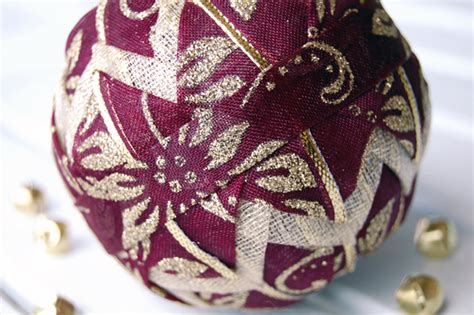 gold poinsettia and burgundy christmas ornament the