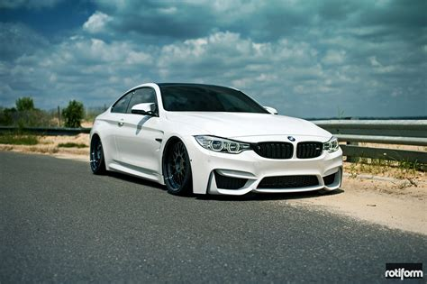 custom white bmw sleek white bmw m4 coupe with subtle custom touches and
