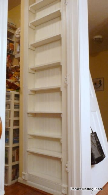the recessed shelves built between studs on a pantry wall