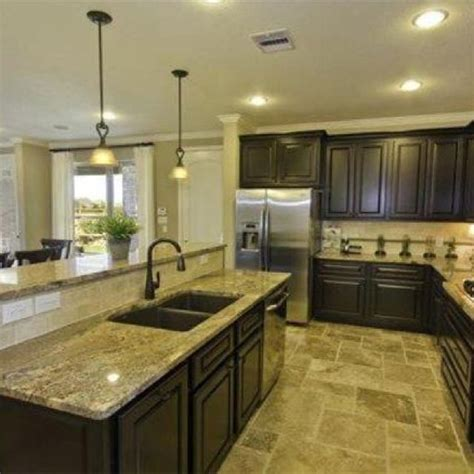 open kitchen love this layout large island with bar seating dining table behind new