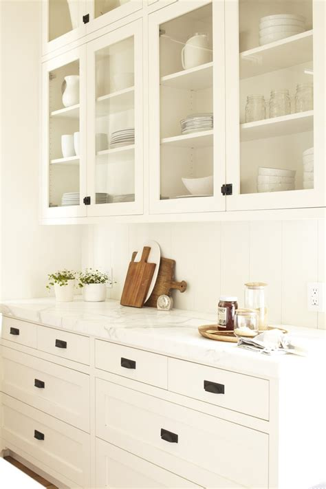 white cabinets with black hardware pin by the styled child on dream house pinterest