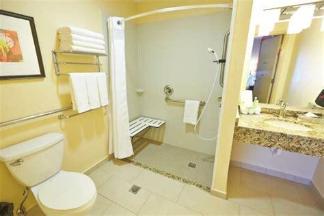 bathroom wall gay holiday inn express el caney lodge on fort buchanan an