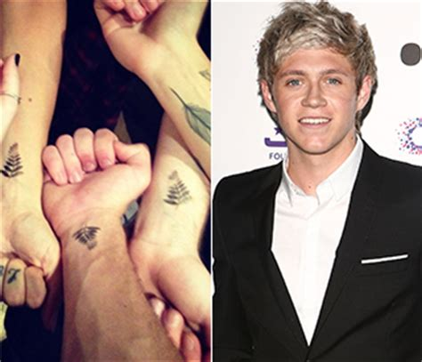 niall tattoo miley cyrus sends liam s clothes to a charity shop