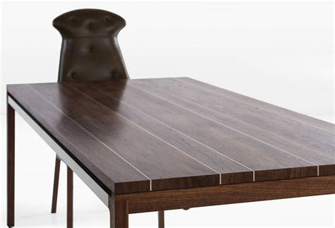 joe dining table with walnut plank top with stainless