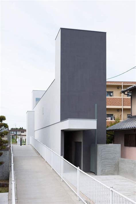 narrow urban home  concrete walls  upper bridge