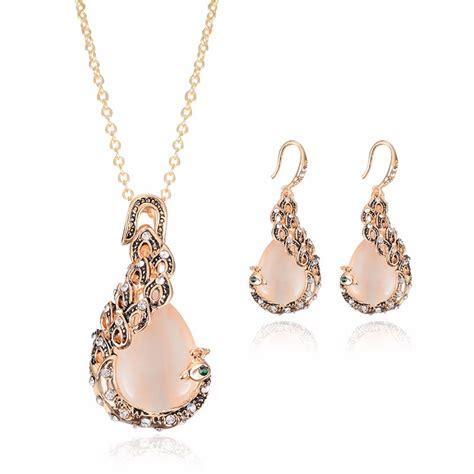 Set Necklace Earrings C73934 Gold rhinestone opal peacock pendant necklace earrings