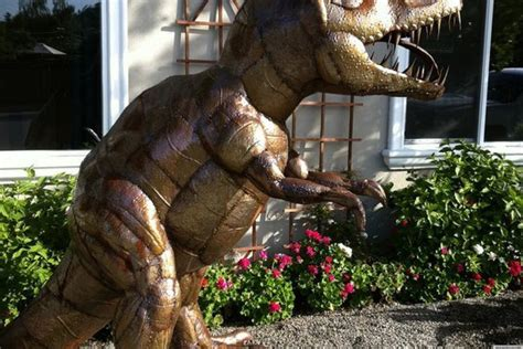 dug   rex lawn dinosaur brings joy   neighborhood