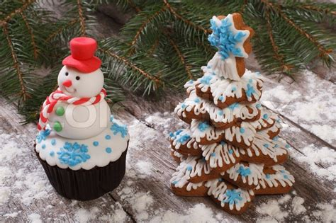 muffin as a snowman and christmas tree cookies stock