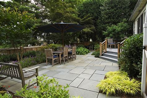 Paver stone patio ideas patio rustic with border plantings deck garden