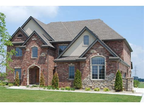 home exterior design with stone custom home front exterior executive style front exterior