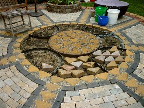 Patio Stones Pavers Wow Thats A Busy Garden Creating A Paver And Pebble Mosaic Patio