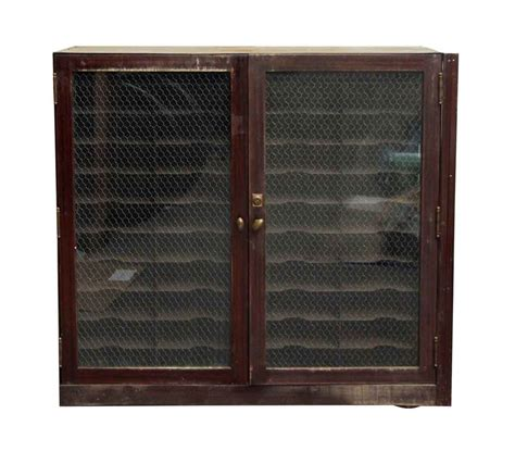metal cabinet with glass doors metal cabinet with chicken wire glass doors olde things