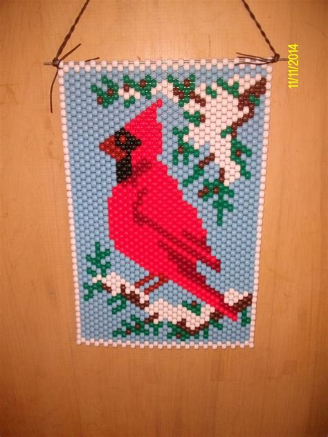 beaded banners cardinal in the snow beaded banner
