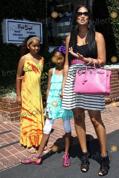 Top Kimora Pink photos and pictures wearing a striped skirt black top and pink belt and carrying a pink