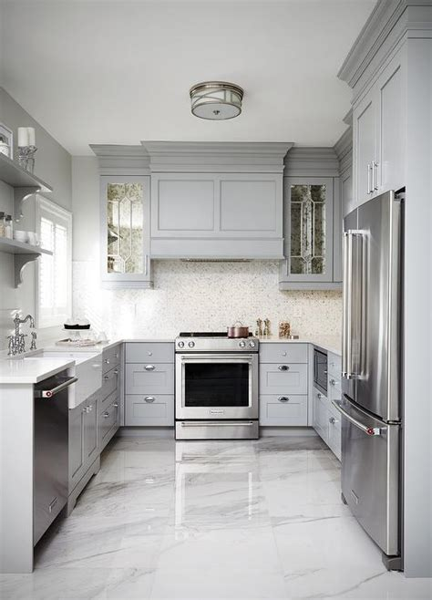 hood range small u shaped kitchen designs white tile backsplash this gray u shaped kitchen features a gray paneled hood