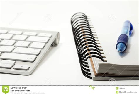 sketchbook and pen keyboard and sketchbook with pen royalty free stock