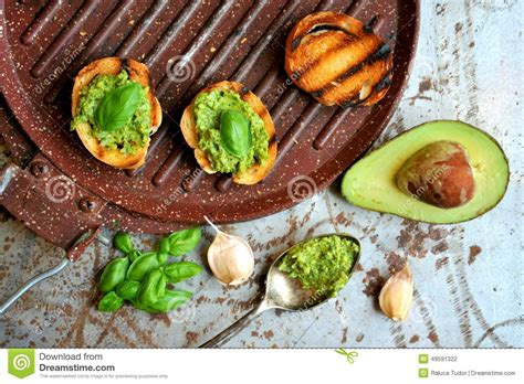 raw fresh alkaline food with avocado and basil pesto with