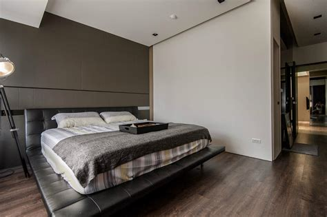 Stone And Wood Make A Dark Masculine Interior Masculine Bed Frames