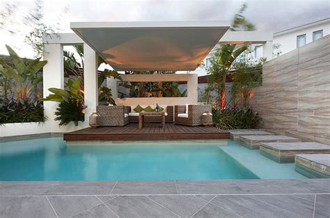 pool area ideas custom pool area covered outdoor lounge patio uplit with pool stepping platforms interior