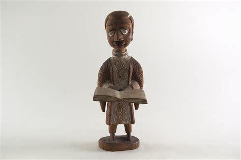 Figure Cur 2 museum arts of africa figure of a clergyman