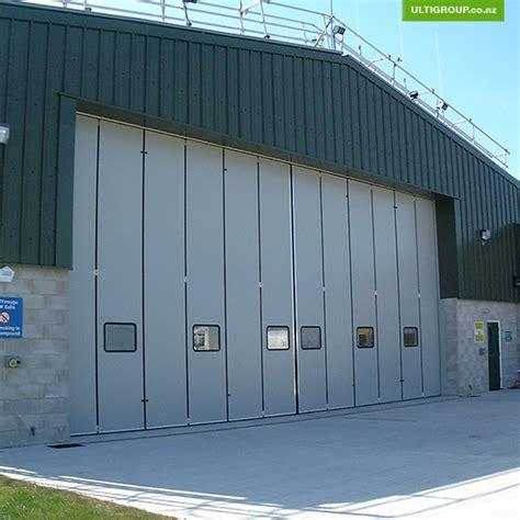 bi fold garage doors vertical collection vertical folding door pictures woonv