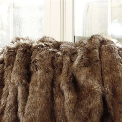 pretty faux fur blanket giving the warmth for