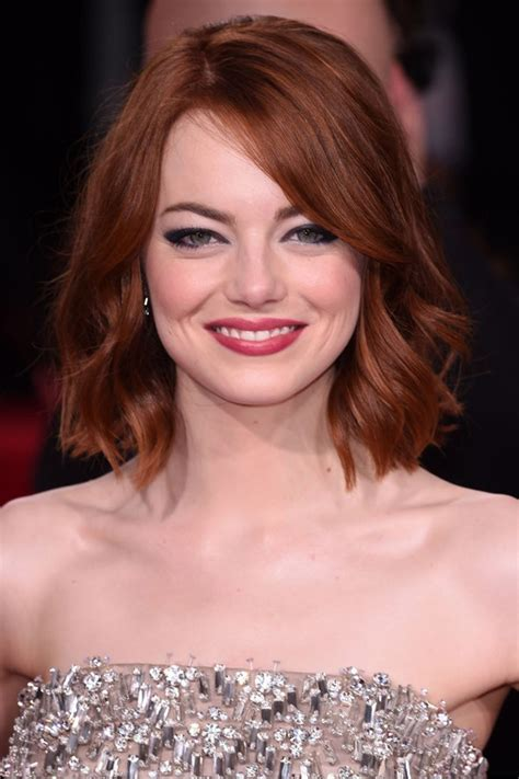 emma stone the rock golden globes 2015 hairstyles red carpet beauty photos