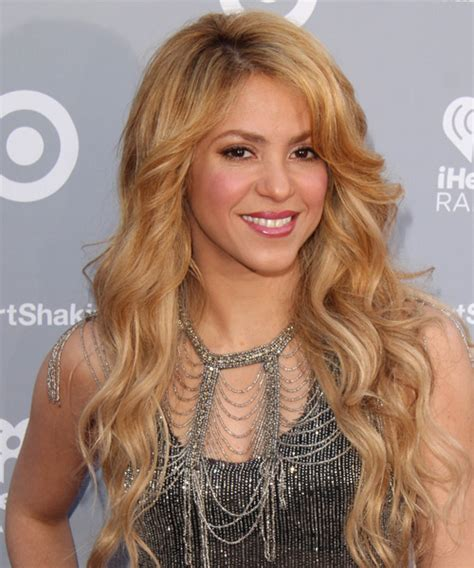 Shakira Hairstyle by Shakira Wavy Casual Hairstyle Medium Golden