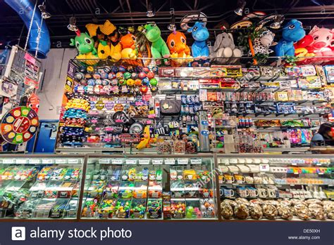 Games Giveaways - a collection of arcade game prizes on display in an amusement park stock photo