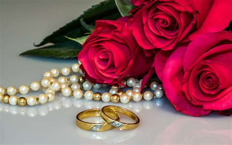red roses flowers wedding rings necklace  pearls photo