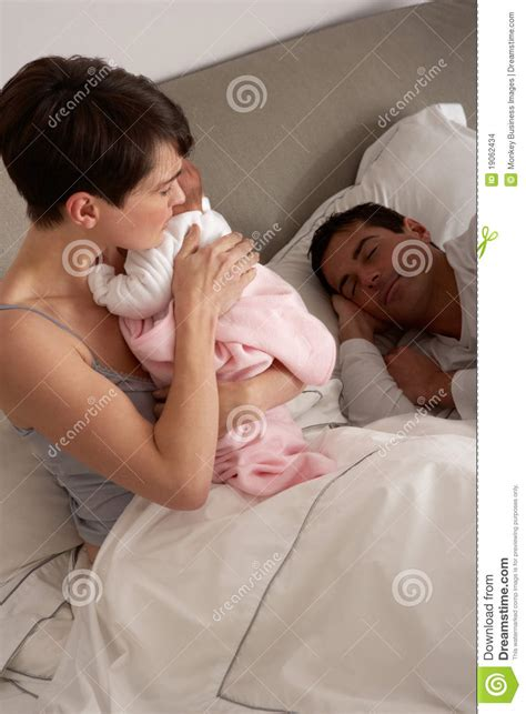 cuddle in bed mother cuddling newborn baby in bed stock images image 19062434