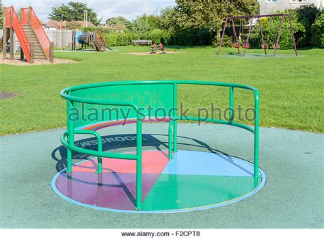 swing bout roundabout in playground stock photos roundabout in