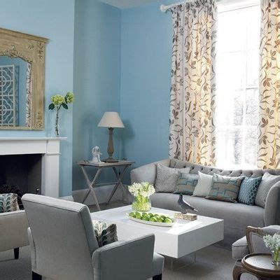 blue and gray living room gray sofa with clean lines white furniture and light