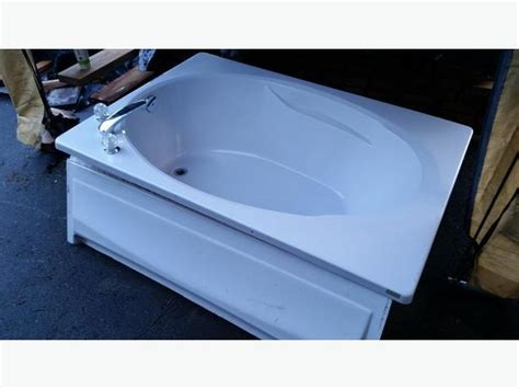 crane bathtub crane soaker bathtub with fixtures and front panel