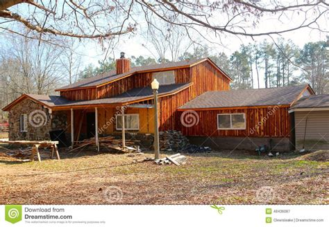 Hunting Cabin Floor Plans Free ranch style home with rustic wood siding stock photo