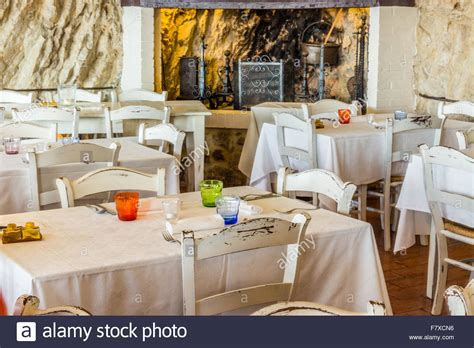white shabby chic table and chairs white chairs and tables in a shabby chic restaurant stock