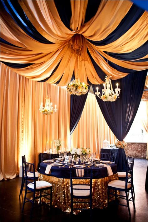 navy blue and gold ceiling draping weddings ceiling