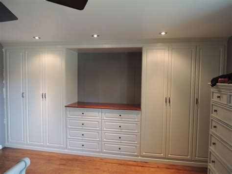 custom white wall unit   master bedroom wall units