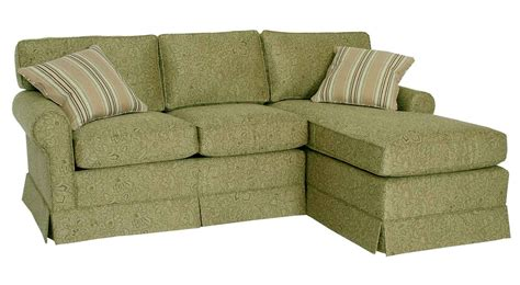 green sectional slipcover sofa with chaise for small space